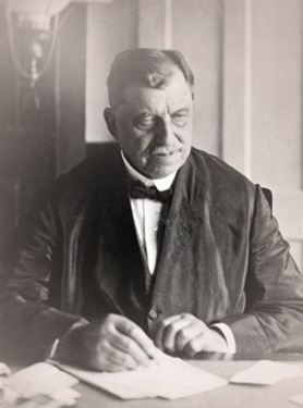 Russell Conwell seated at a desk