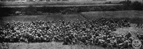 Soldiers resting in a field