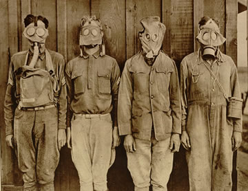 soldiers wearing various types of gas masks