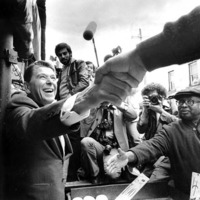 President Ronald Reagan shakes hands with a crowd
