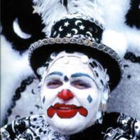 Philadelphia Mummer in a festive costume with clown makeup