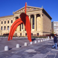 Red abstract sculpture in front of the PMA