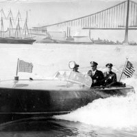 two policemen riding in a speedboat with an American flag decorating the back&lt;br /&gt;<br />