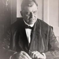 Russell Conwell, seated at a desk