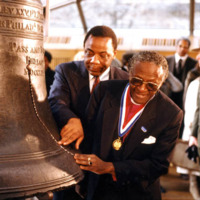 Mayor Wilson Goode and Bishop Desmond Tutu touch the Liberty Bell