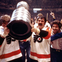 Hockey players of the Philadelphia Flyers hold up trophy