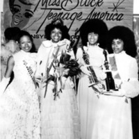 Four Miss Black Teenage America contestants pose with their trophies and bouquets.
