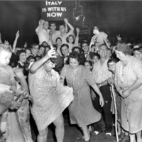 Group of people in the street celebrating the Allied forces victory in Italy.