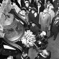 Members of the Freedom Day Association gathered around the Liberty Bell to decorate it.