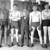 "Four boxers posing with Max ""Boo Boo"" Hoff, who is much shorter than the boxers"