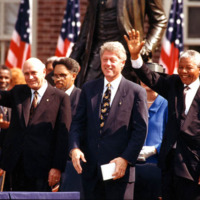 Frederik Willem de Klerk, Bill Clinton, and Nelson Mandela wave to a crowd