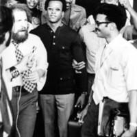 Huey P. Newton among a crowd of people