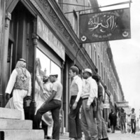 A group of men entering a Mosque.