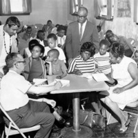 A group of African American students filling out applications to Gerard College at a table.