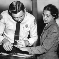 Rose Parks getting her fingerprints taken by an Alabama police officer.